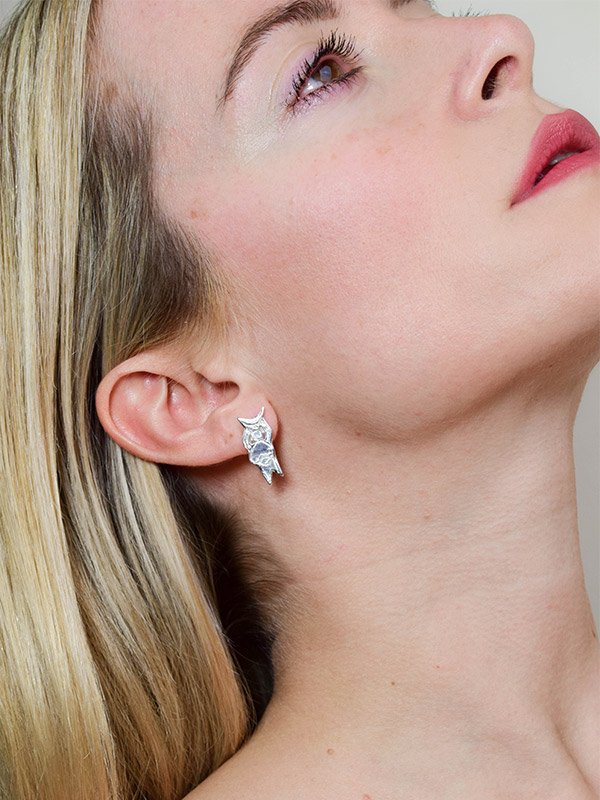 Female figure earrings
