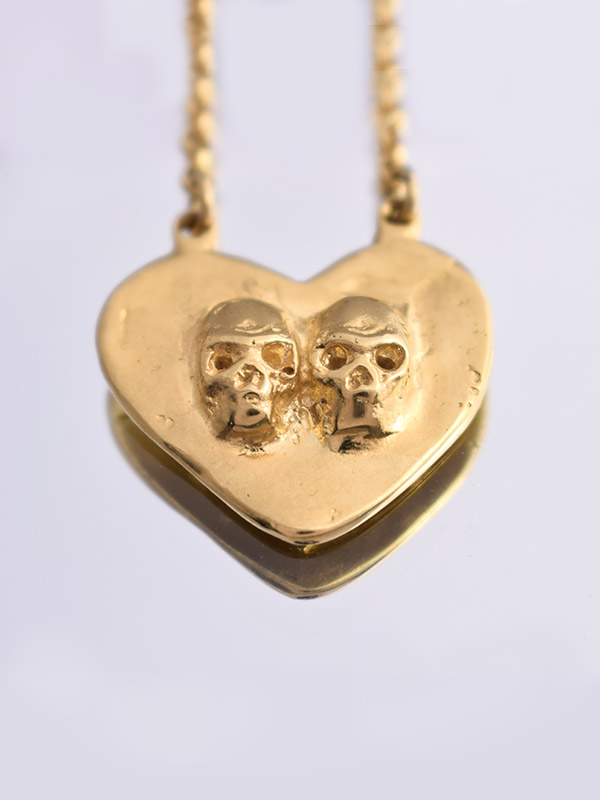 Skulls and heart necklace