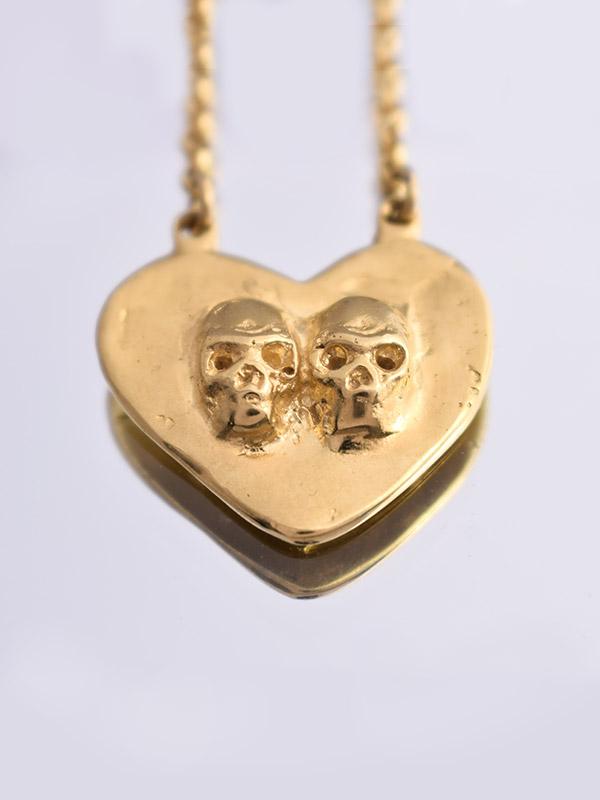 Skulls heart necklace
