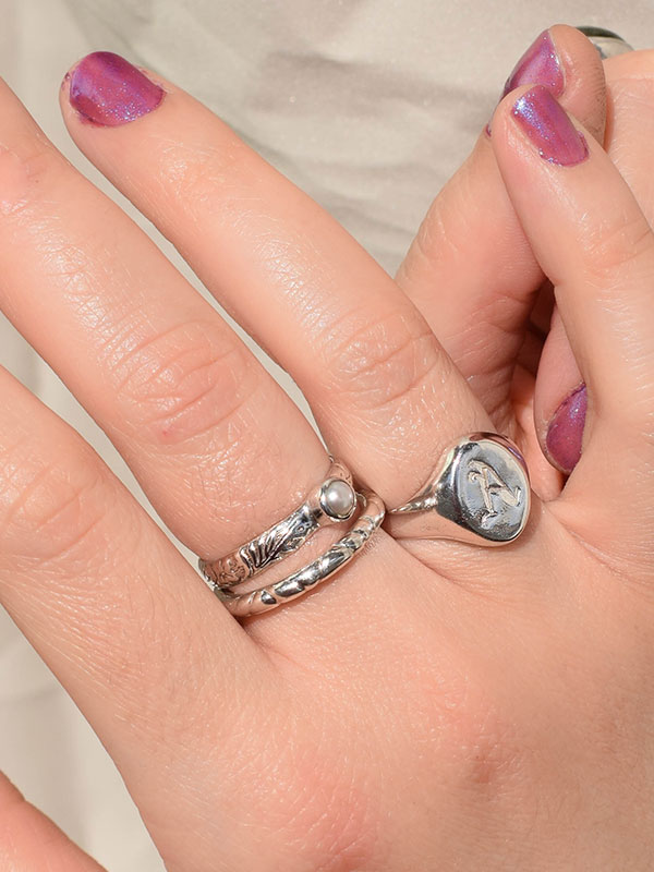 Oval signet ring with initial