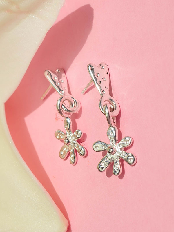 Heart and daisy stud earrings