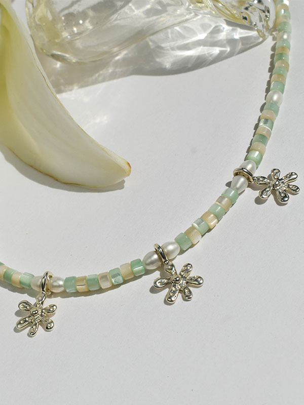 Beaded necklace with charms