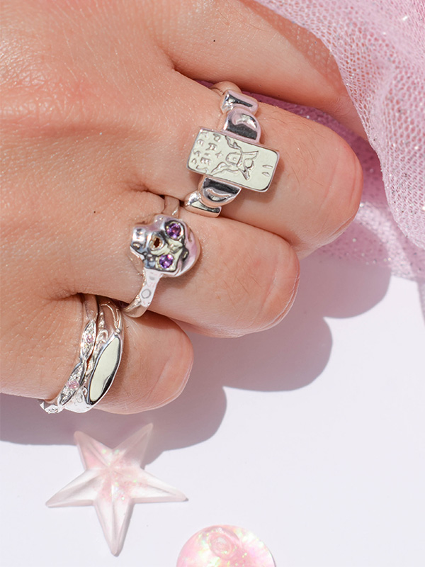 Thin silver ring with pink cz crystals