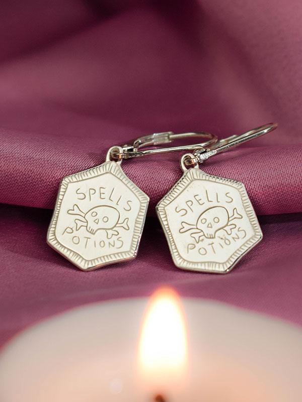 Spells and potions skull earrings